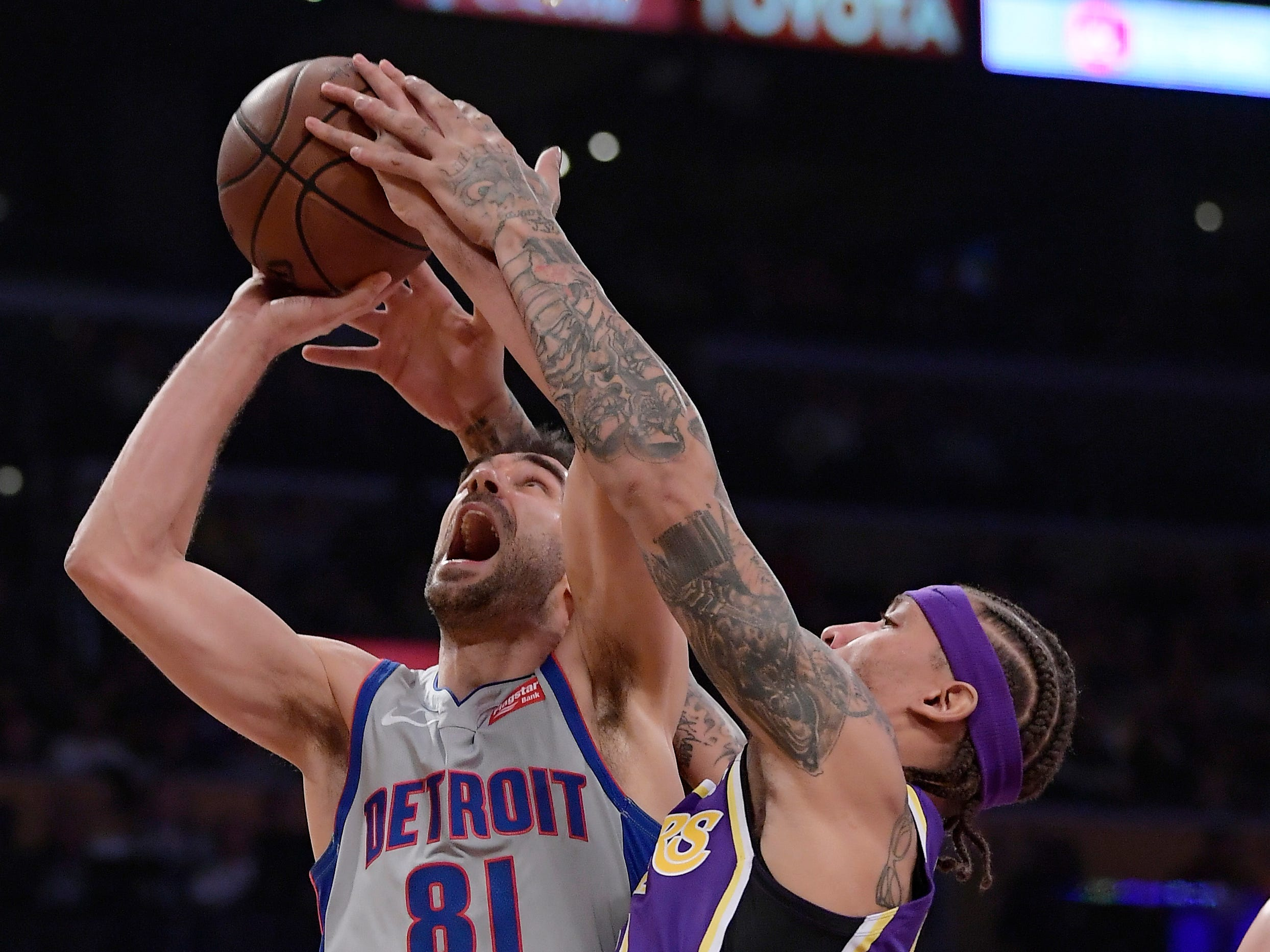 Los Angeles Lakers forward Michael Beasley, right, ties up Detroit Pistons guard Jose Calderon as Calderon tries to shoot during the first half of an NBA basketball game Wednesday, Jan. 9, 2019, in Los Angeles.