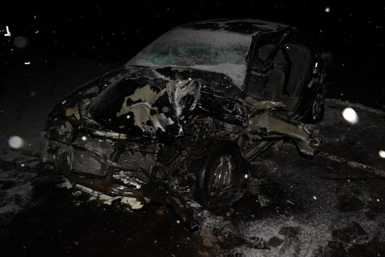 A Nissan Sentra is destroyed after a head-on collision in Berrien County, Michigan, on Jan. 9, 2019.