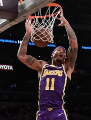 Lakers forward Michael Beasley dunks the ball against the Pistons at the Staples Center on Jan. 9, 2019, in Los Angeles.