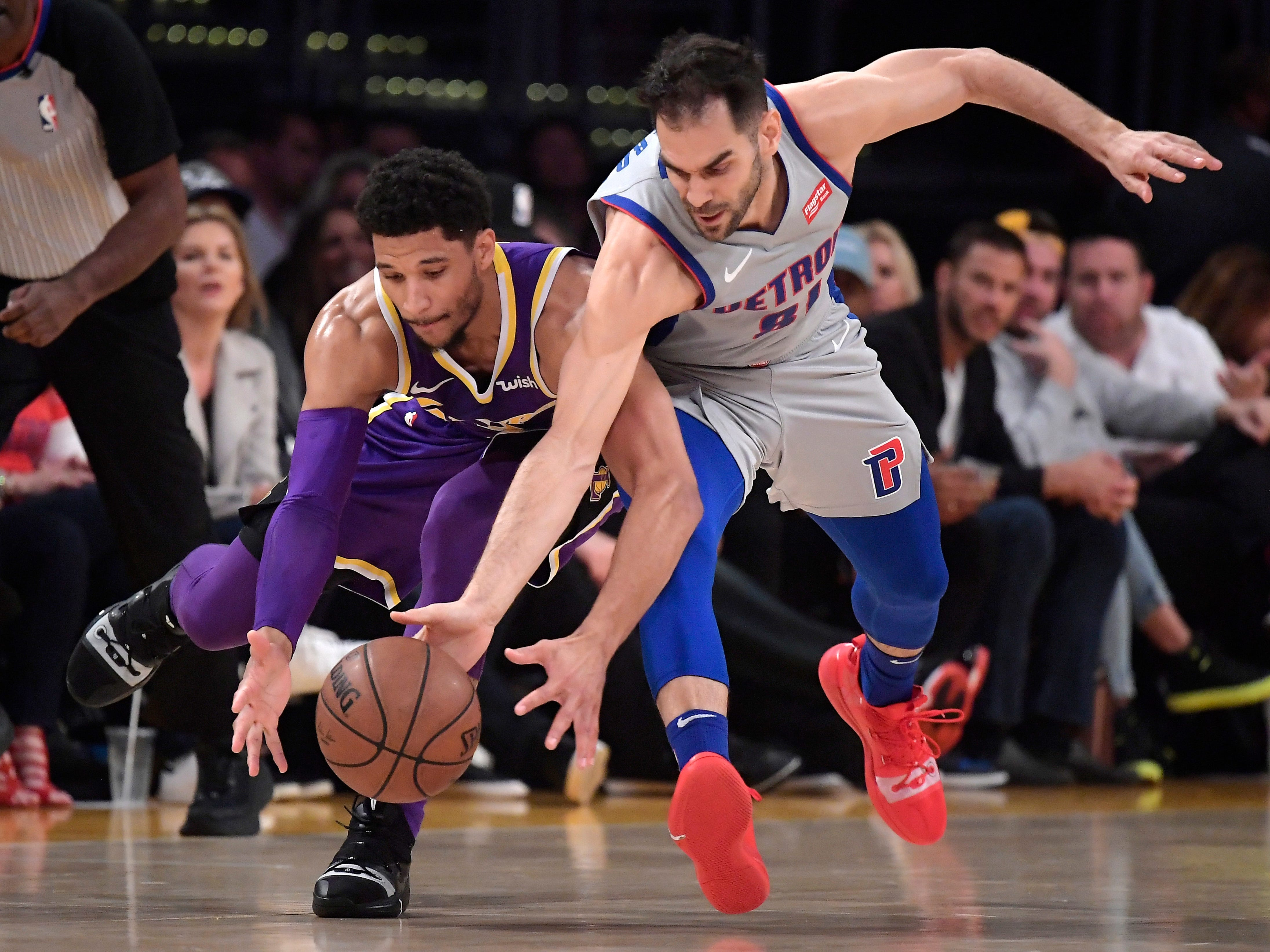 Los Angeles Lakers guard Josh Hart, left, and Detroit Pistons guard Jose Calderon go after a loose ball during the first half of an NBA basketball game Wednesday, Jan. 9, 2019, in Los Angeles.
