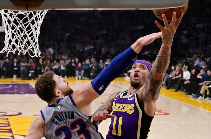 Los Angeles Lakers forward Michael Beasley, right, shoots as Detroit Pistons forward Blake Griffin defends during the first half of an NBA basketball game Wednesday, Jan. 9, 2019, in Los Angeles.