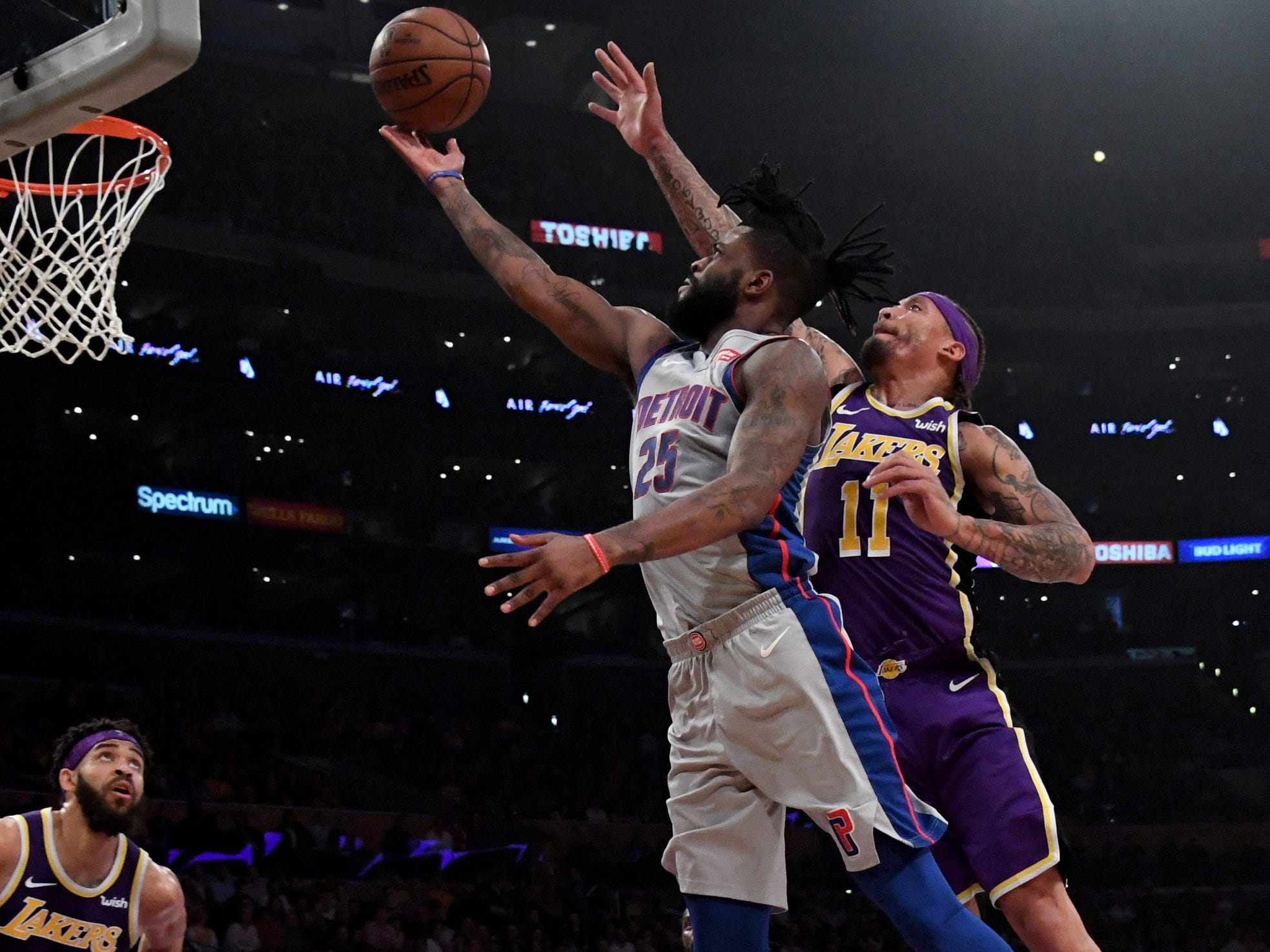 Detroit Pistons guard Reggie Bullock (25) drives to the basket as Los Angeles Lakers forward Michael Beasley (11) defends during the first half at the Staples Center on Wednesday, Jan. 9, 2019, in Los Angeles.