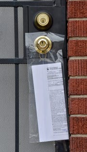 This rental-ordinance-related ticket is securely taped to the front door of this rental property in a weather-resistant plastic bag.