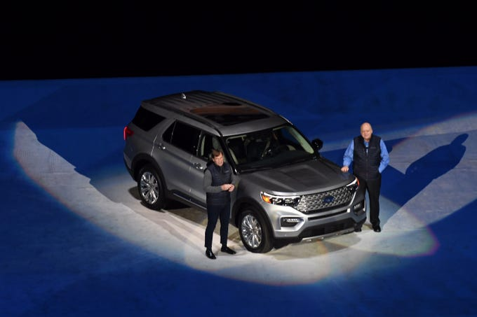 Jim Farley, vice president and president of Global Markets, has left Jim Hackett, CEO of Ford, presenting 2020 Ford Explorer at Ford Field Press Release, 2019 January 9