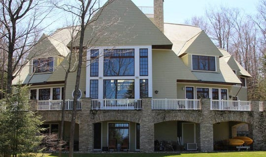 Located on a 2.3 acre lot in the luxury community of Bay Harbor near Petoskey, this two-story, 9,350 square-foot home features a steam room, billiards room, wine room and a 1,417 square-foot guest house.