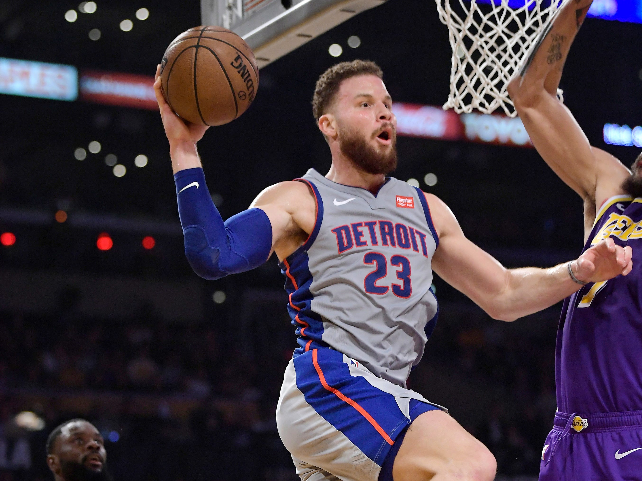 Detroit Pistons forward Blake Griffin looks to pass the ball as Los Angeles Lakers guard Lance Stephenson, left, defends during the first half.