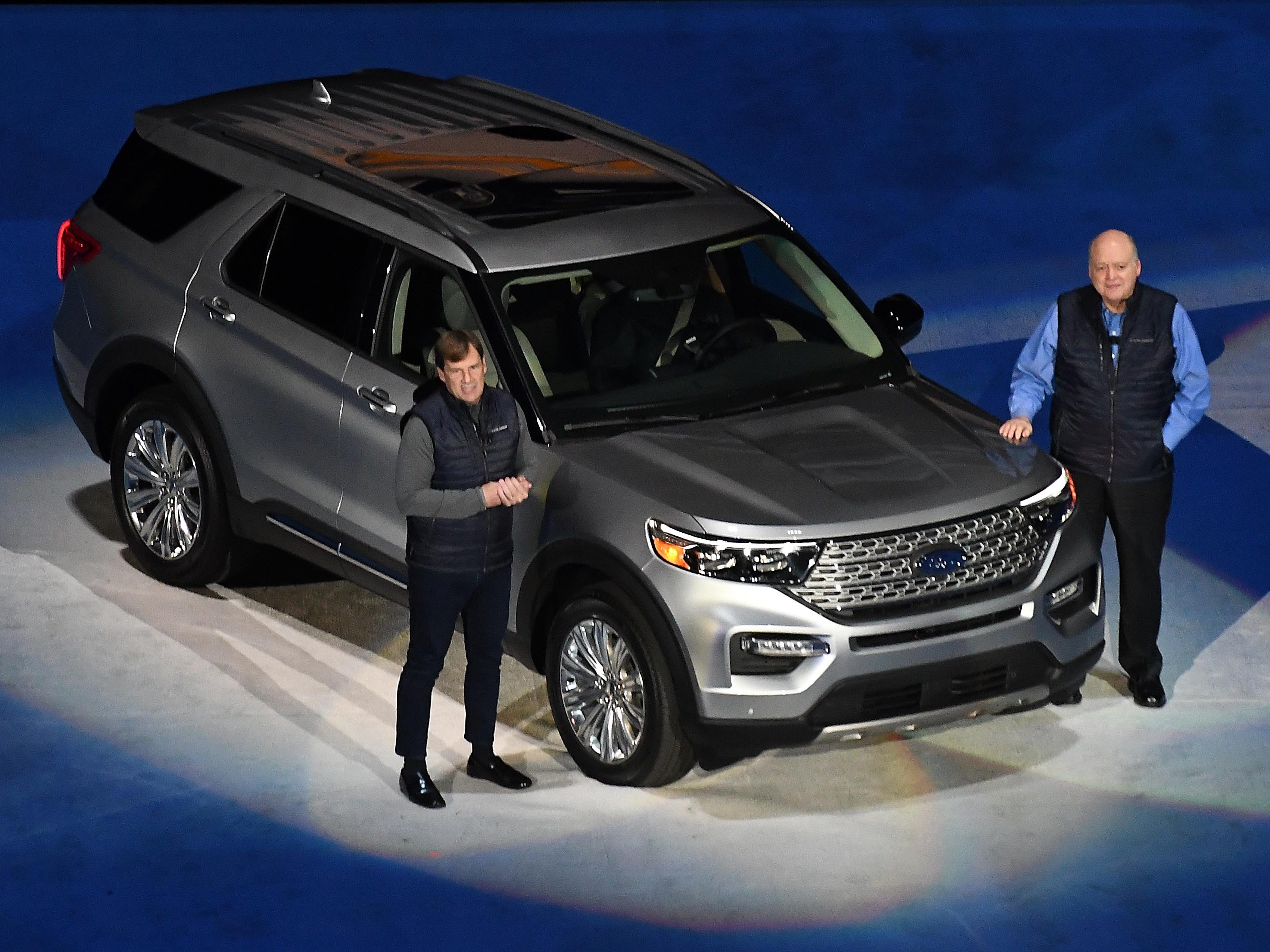 Jim Farley, executive vice president and president of Global Markets, left, and Jim Hackett, CEO of Ford, present the 2020 Ford Explorer at a press event at Ford Field, January 9, 2019.