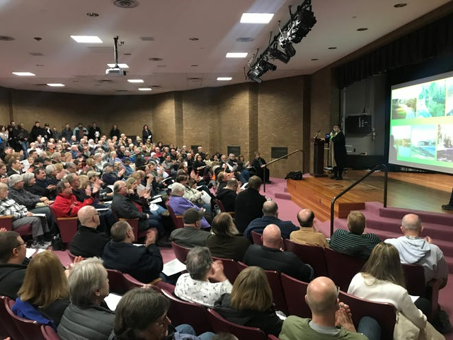 More than 300 people attended a meeting organized by opponents of county redevelopment plans for HInes Park property  at the Bennett Civic Center Library in Livonia on Wednesday, Jan. 9, 2019.