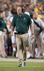 Michigan State head coach Mark Dantonio (pictured) shook up his offensive coaching staff on Thursday, elevating Brad Salem to offensive coordinator.