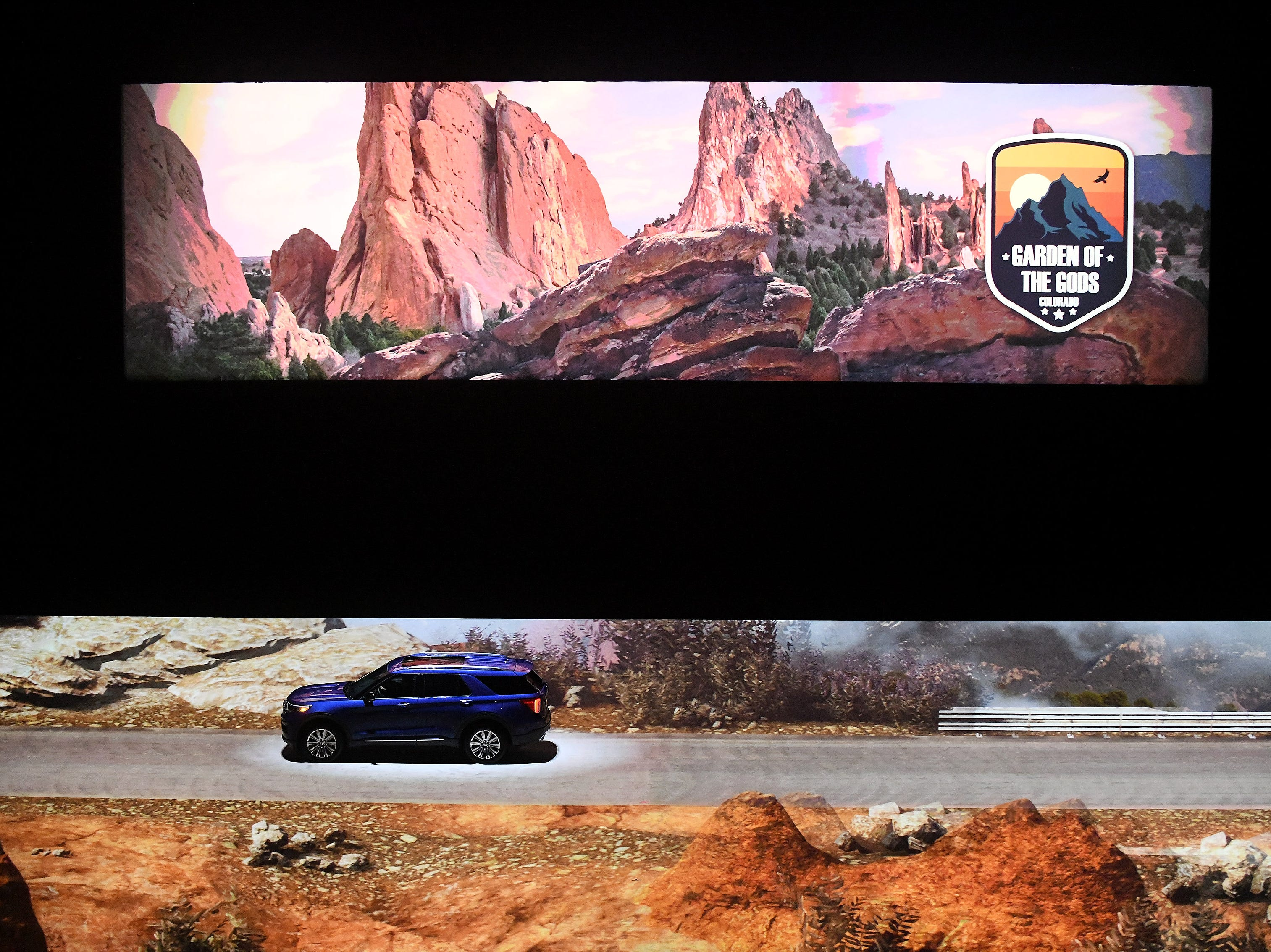 A 2020 Ford Explorer appears to be driving through the Garden of the Gods due to video effects on the floor of Ford Field.