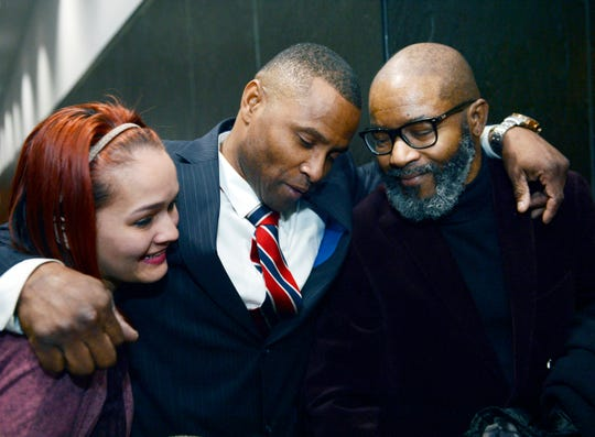 Kevin Lackey, who had a criminal sexual conduct conviction dismissed, hugs his daughter Shannen Lackey, 27, and his brother Prince Lackey, 58, after the hearing.