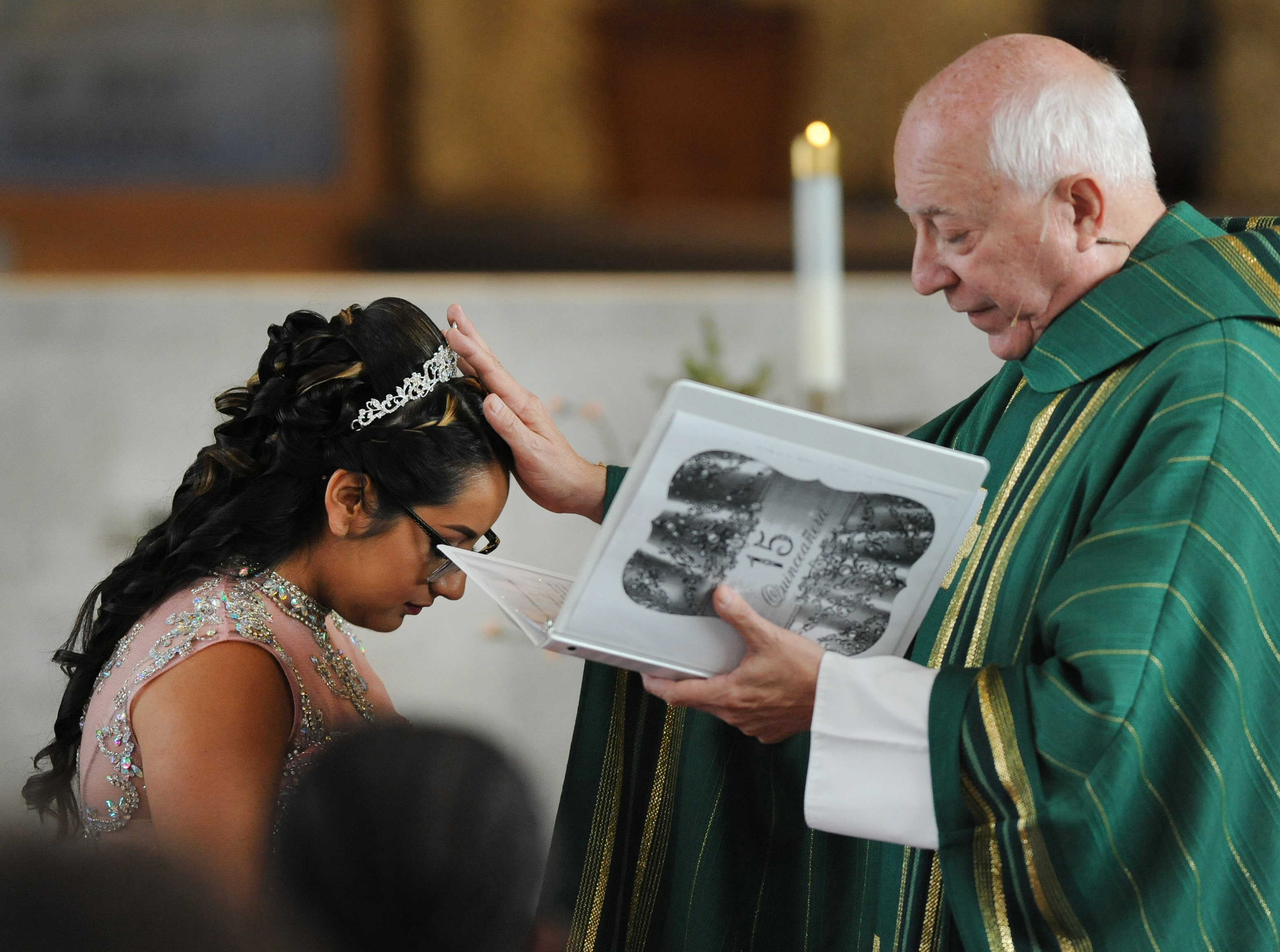 "The Rev. Edward Zaorski blesses Soleil during the mass. During his homily, he seemed to directly speak to Jorge. ""We want you to know that she loves you and you love her,"" Zaorski said. ""And hopefully the things that are in the way of you being with your daughter and your family are changed."""