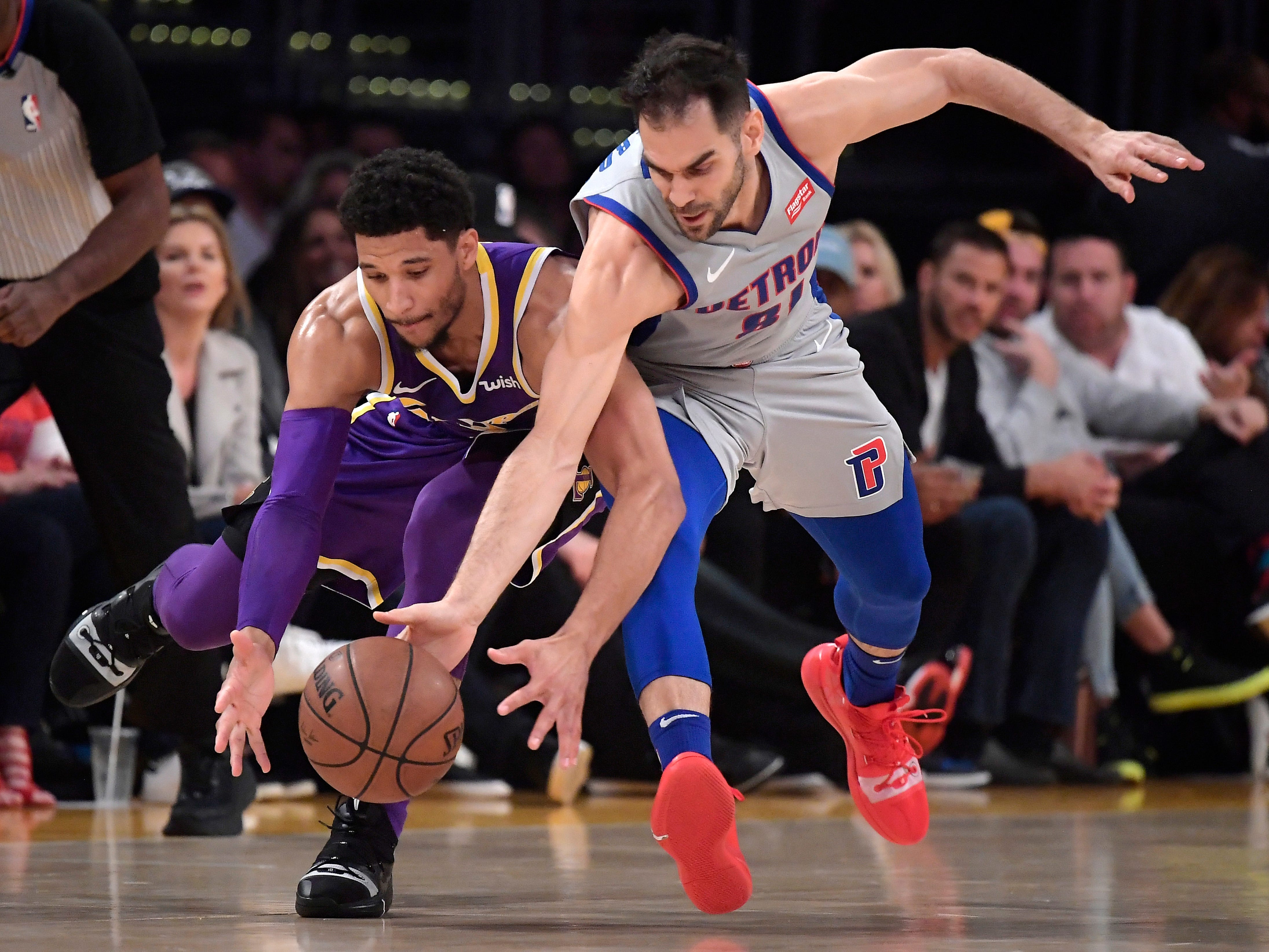 Los Angeles Lakers guard Josh Hart, left, and Detroit Pistons guard Jose Calderon go after a loose ball during the first half of an NBA basketball game Wednesday, Jan. 9, 2019, in Los Angeles. The Lakers won the game, 113-100.