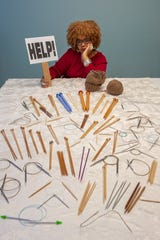 Jocelynn Brown and her collection of too many knitting needles.