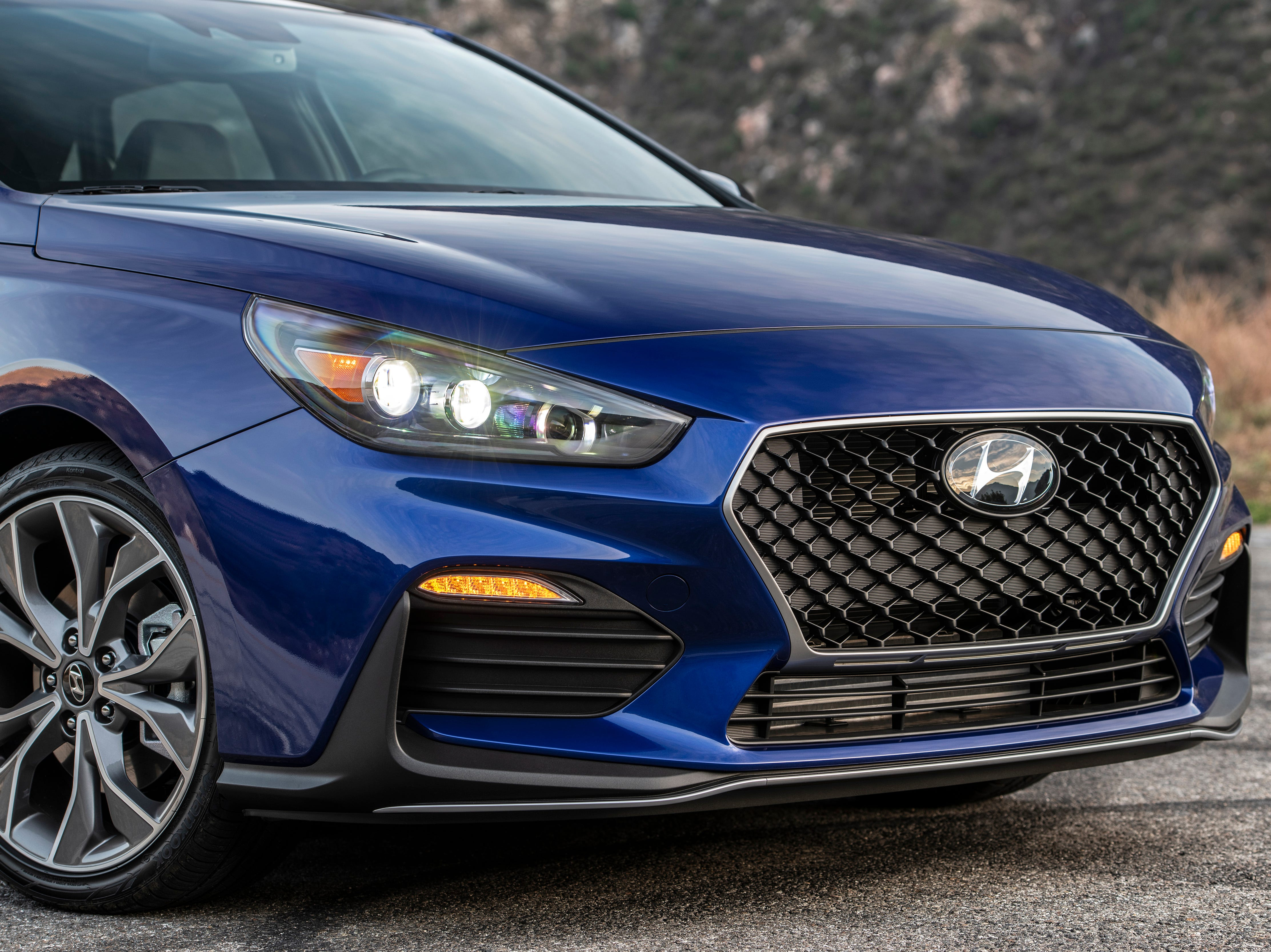 """""""At the front, the Elantra GT N Line has a lower front spoiler for increased aerodynamic efficiency and a unique N Line version of Hyundai's Cascading Grille with a distinctive silver character line."""""""