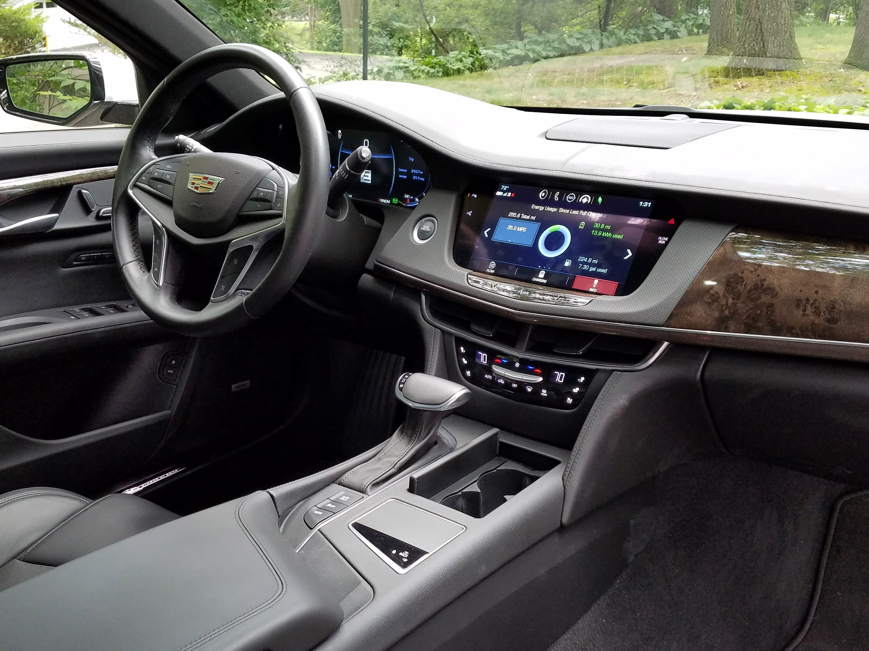 The 2017 Cadillac CT6 interior is nicely appointed with leather, wood accents, a T-shifter, heads-up display, and an 8-inch infotainment display with smart phone app connectivity.