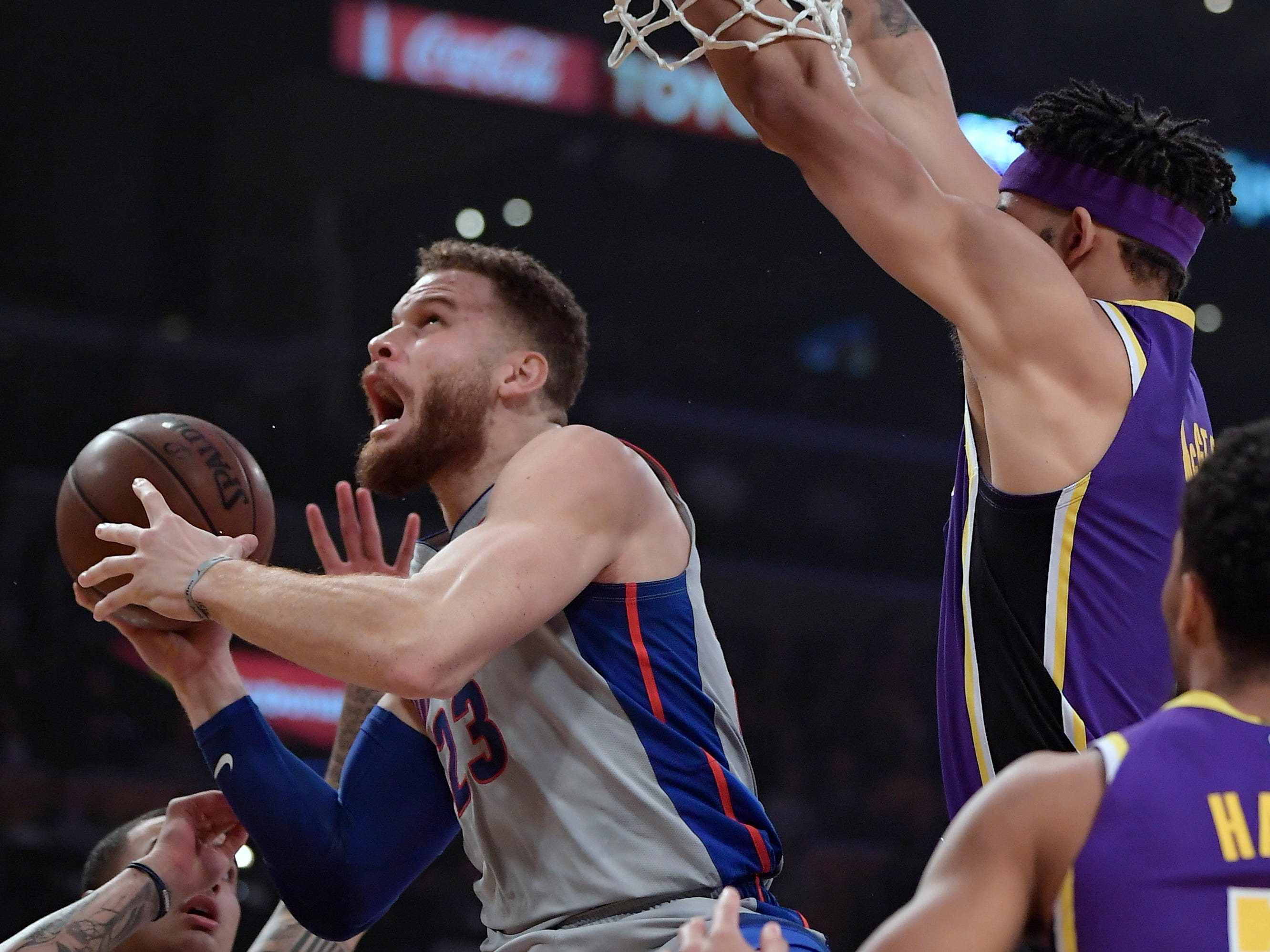 Detroit Pistons forward Blake Griffin, second from left, prepares to shoot as Los Angeles Lakers forward Kyle Kuzma, left, and center JaVale McGee, second from right, defend during the first half.