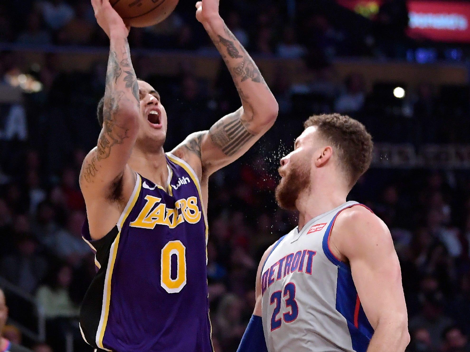 Los Angeles Lakers forward Kyle Kuzma, left, shoots as Detroit Pistons forward Blake Griffin defends during the second half.