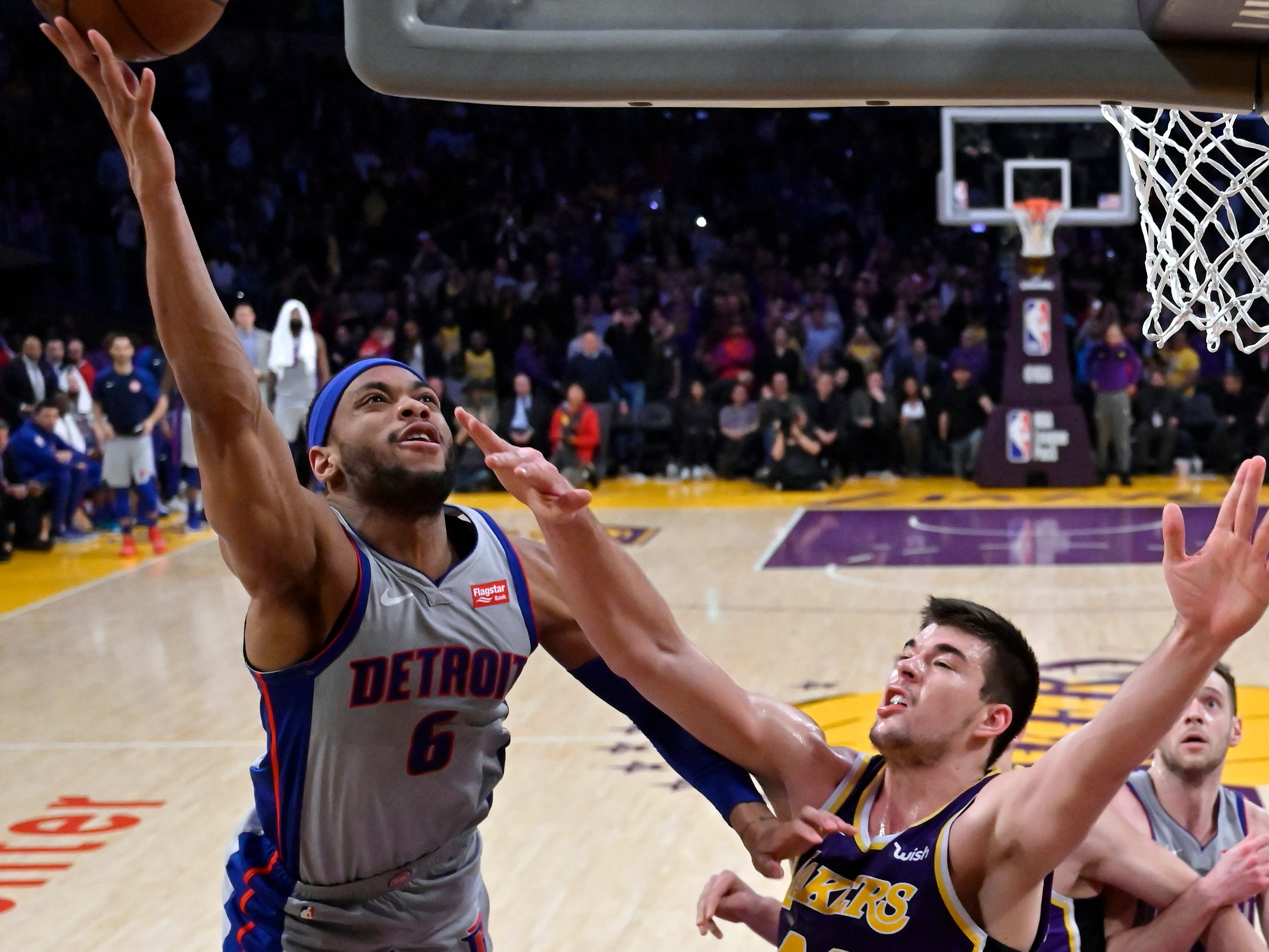 Detroit Pistons guard Bruce Brown, left, shoots as Los Angeles Lakers center Ivica Zubac defends during the second half.