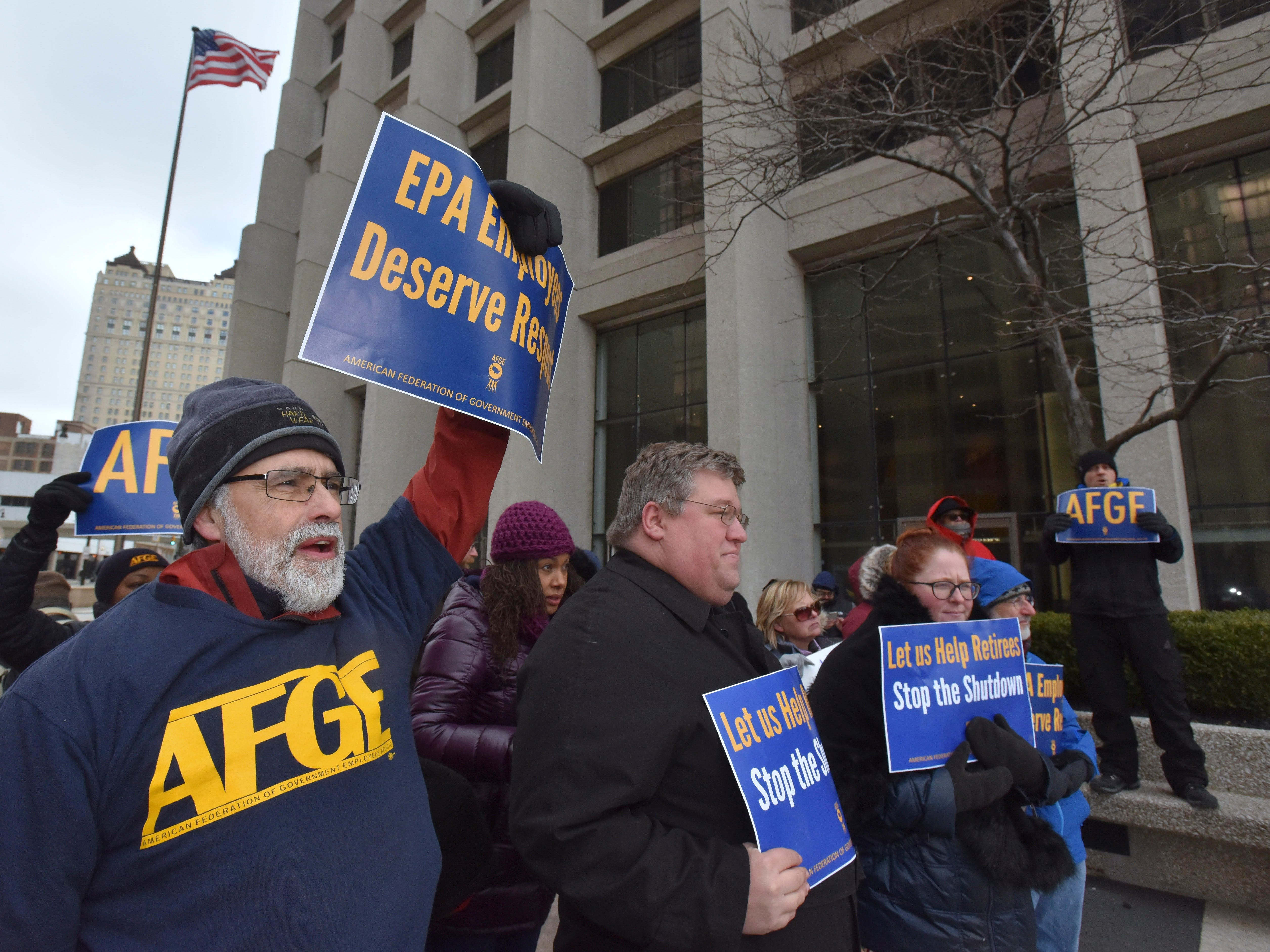 EPA Mechanical Engineer Tad Wysor, left, of Ypsilanti, listens to speakers. He is V.P. of AFGE Local 3907.