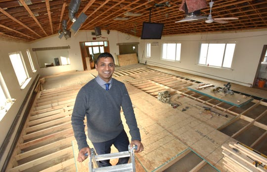 Life Lab Kids founder Jai Reddy stands in the sanctuary of a former church in Ferndale that's being transformed into a gym.