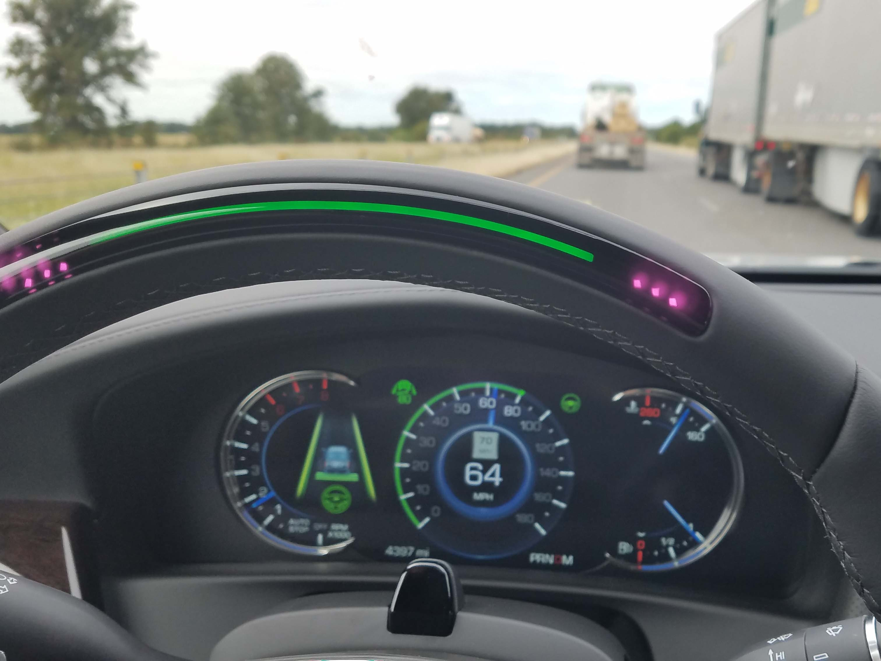 A green light atop the steering wheel indicates when SuperCruise is in operation. The light indicates blue as the driver centers the car upon entering a highway -- and it will turn red if the camera (mounted on top of the steering column) detects the driver is inattentive.