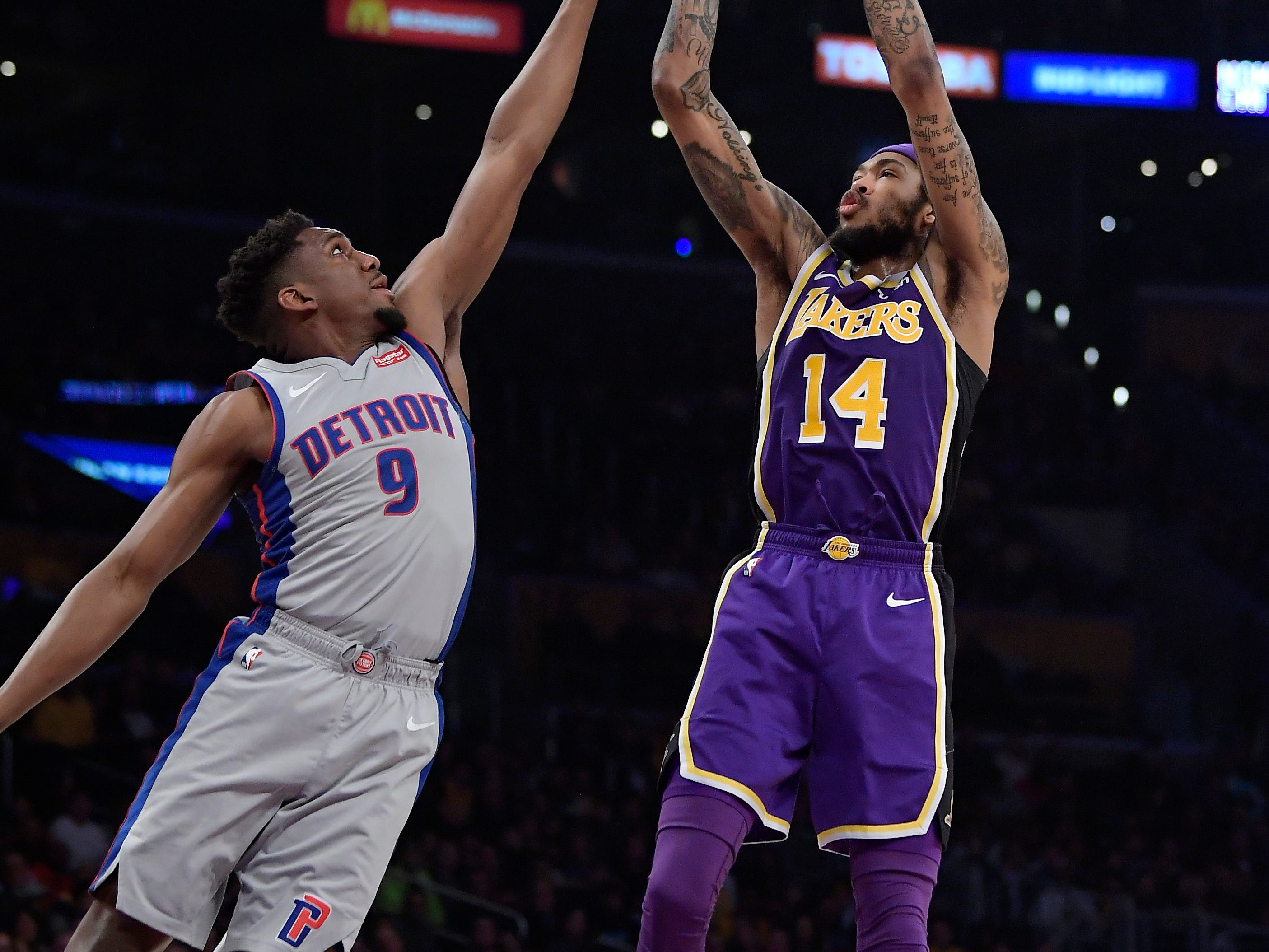 Los Angeles Lakers forward Brandon Ingram, right, shoots as Detroit Pistons guard Langston Galloway defends during the second half.