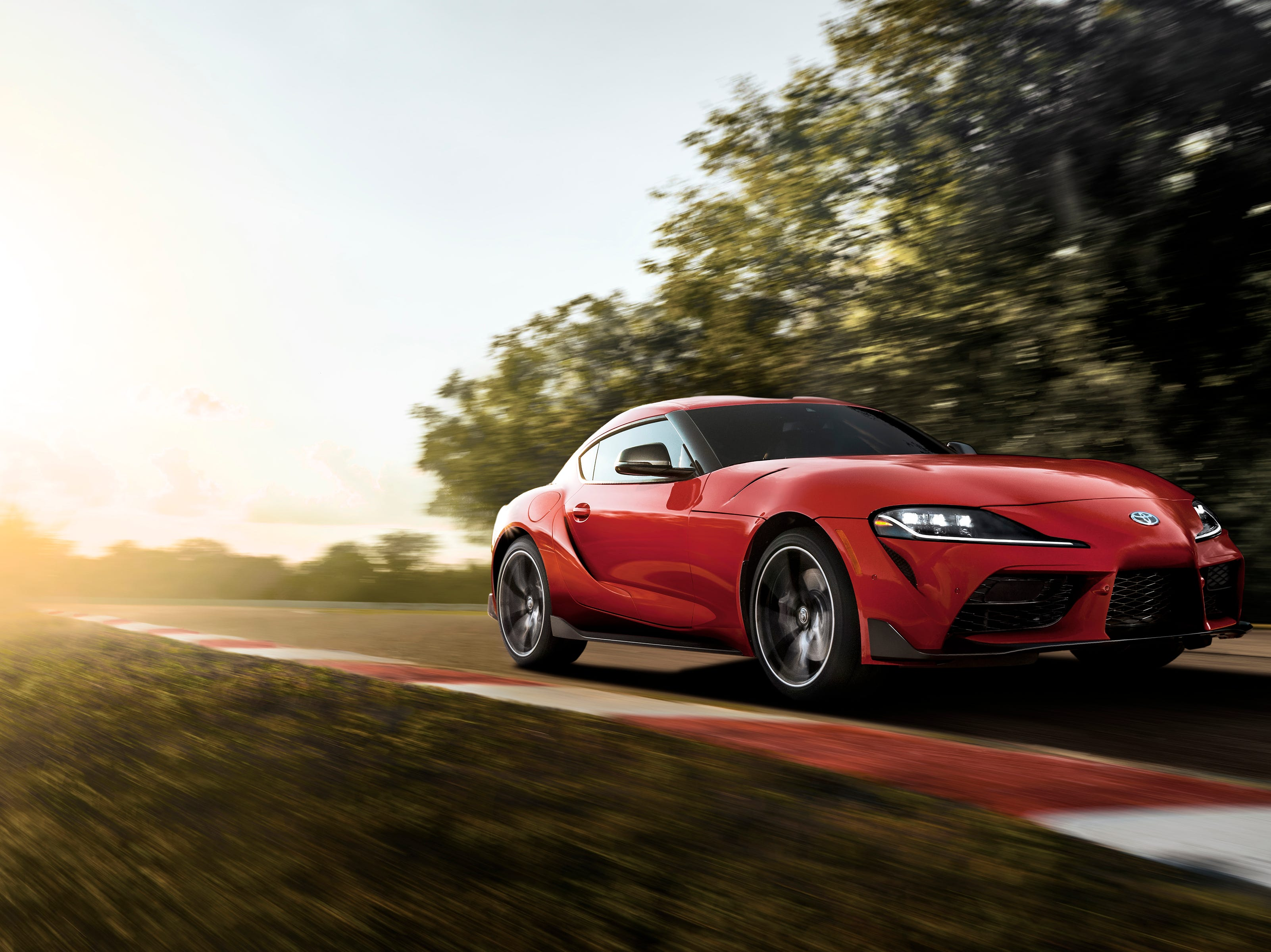 """""""The front fascia was inspired by the fourth-generation Supra with a prominent central grille section flanked by large air intakes."""""""
