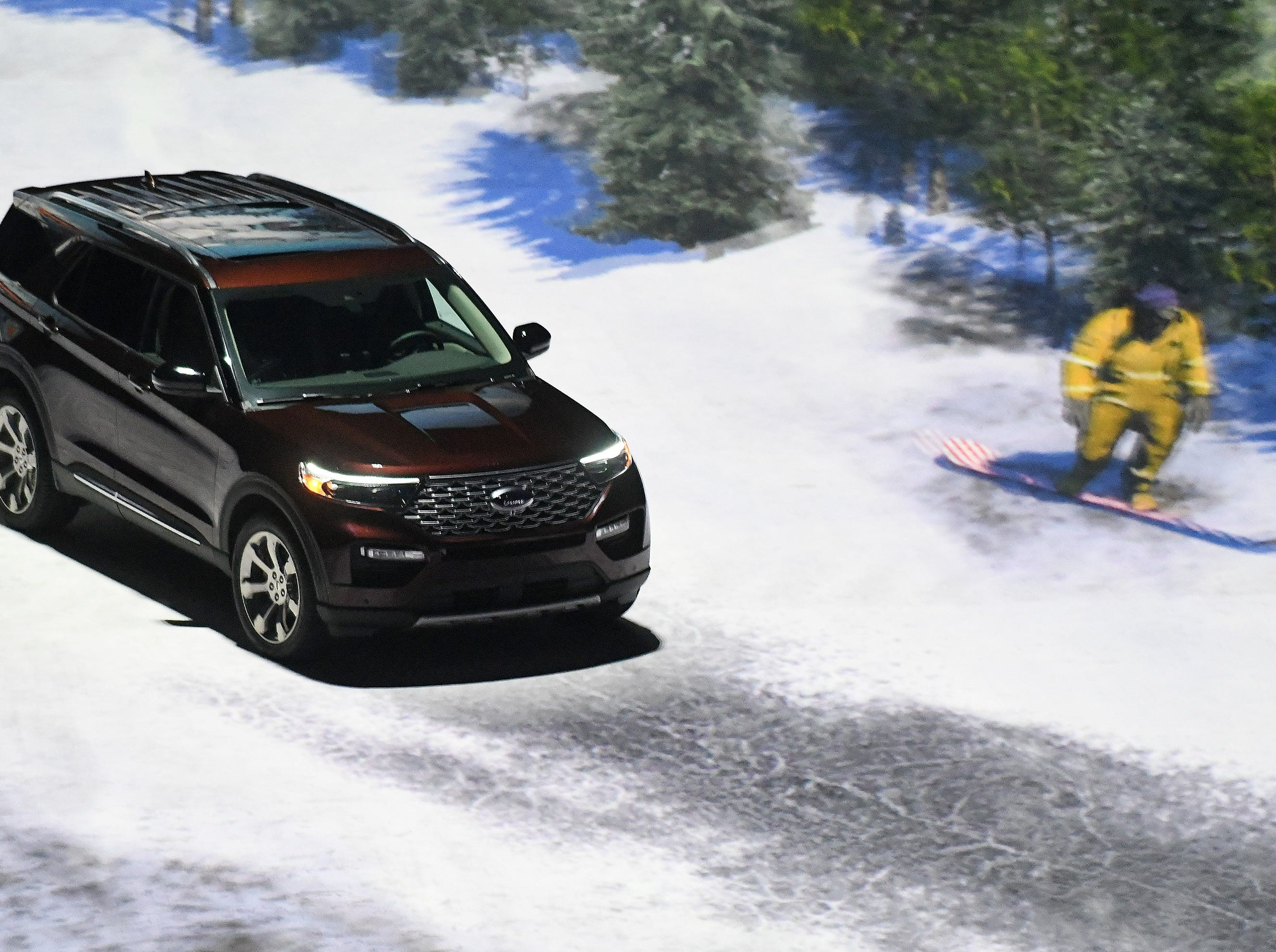 A 2020 Ford Explorer appears to be driving through a snowy wooded area due to video effects.