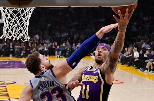 Los Angeles Lakers forward Michael Beasley, right, shoots as Detroit Pistons forward Blake Griffin defends in a game last season. Beasley and Griffin are teammates now.