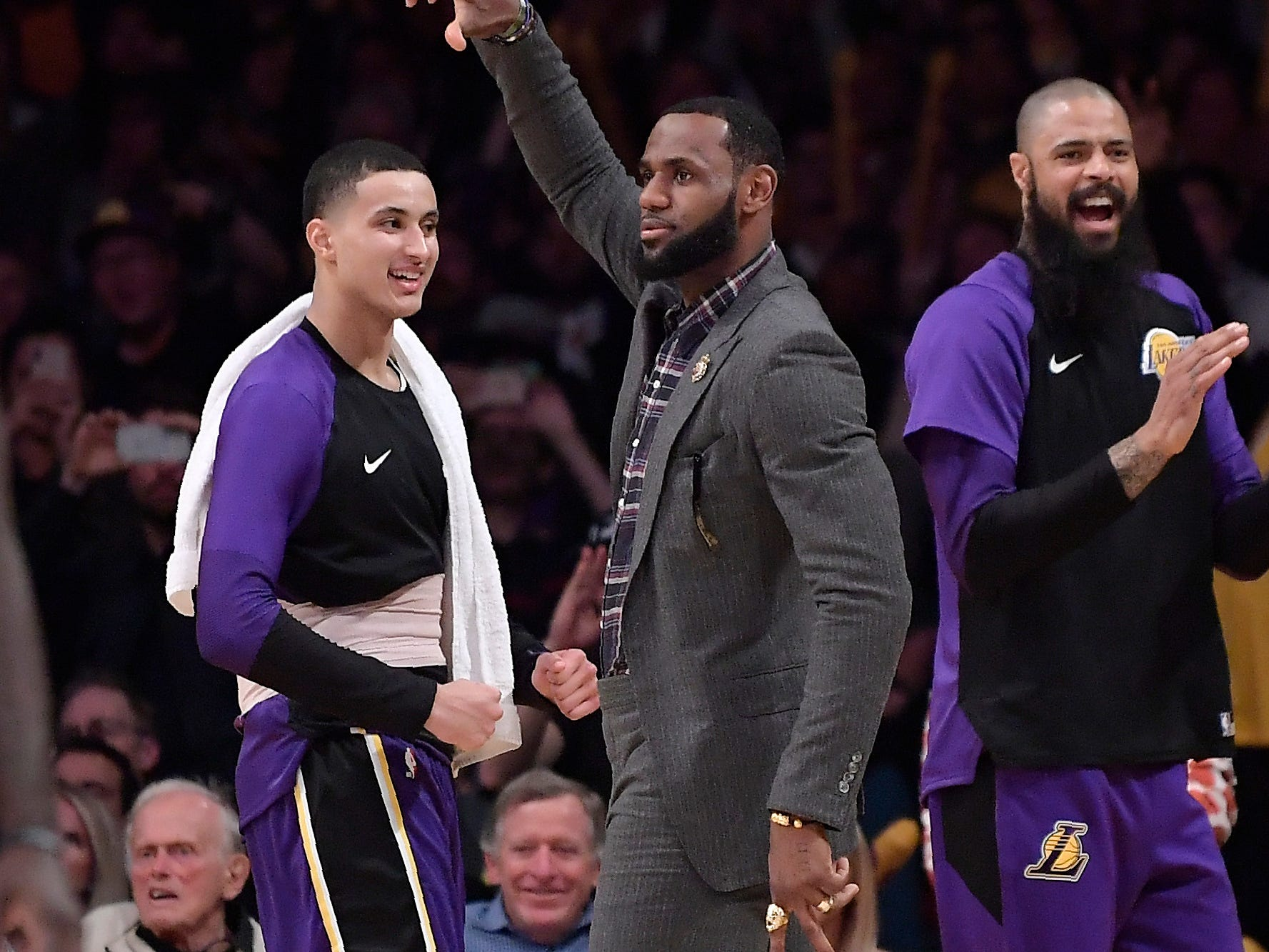 Los Angeles Lakers forward LeBron James, center, celebrates along with forward Kyle Kuzma, left, and center Tyson Chandler after the Lakers scored during the second half.