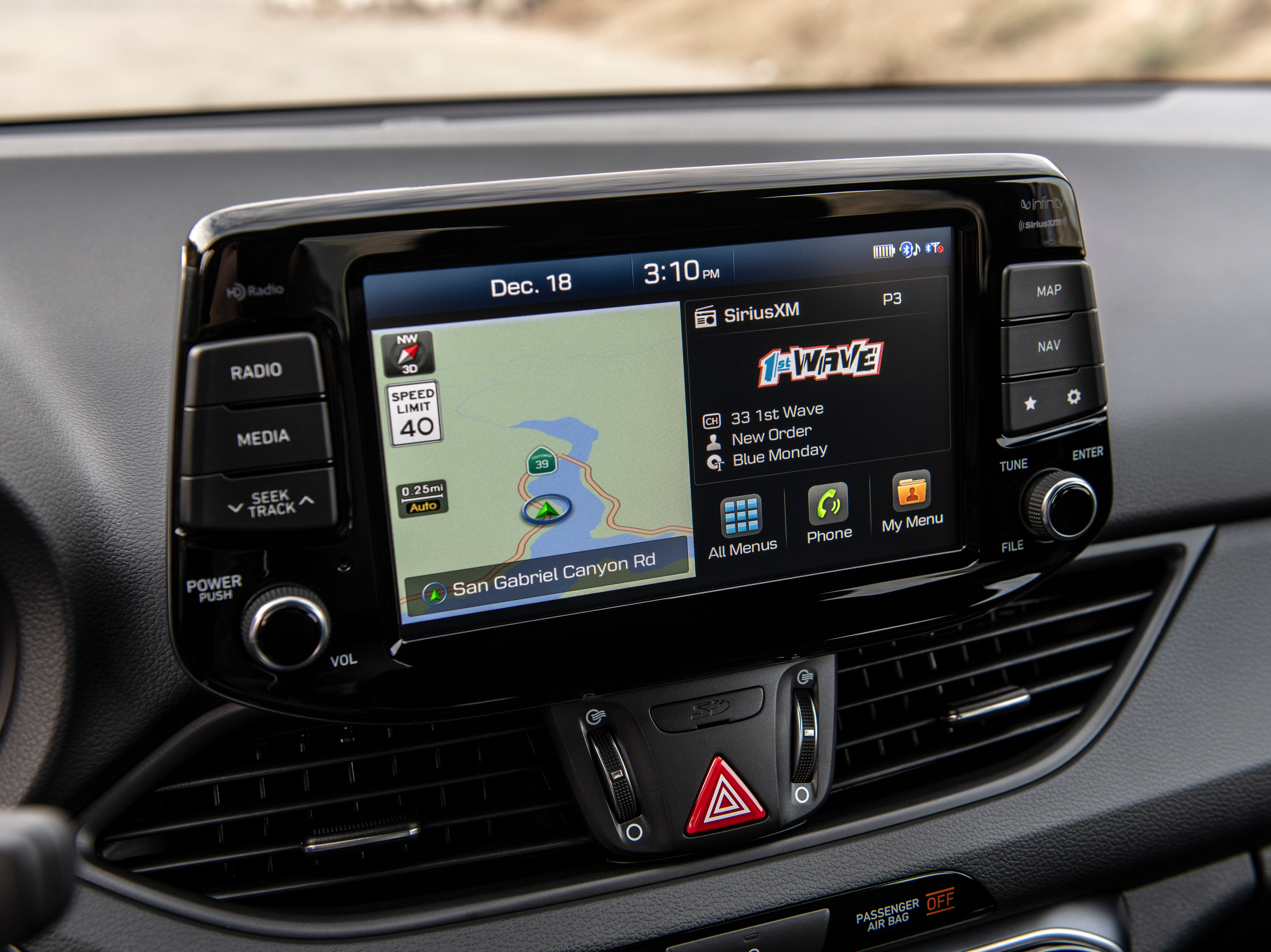 """""""Available on the 2019 Elantra N Line is Hyundai's AVN 5.0 infotainment system. This system features a fast processor for greater responsiveness, as well as an eight-inch screen. Using presets with AVN 5.0 is a snap because AM, FM and SiriusXM channels are combined on one screen. AVN 5.0 also includes HERE HD Traffic (without a subscription), bird's eye view in Navigation maps and drivers get traffic flow and incident data without ever paying for a subscription via HD Radio."""""""