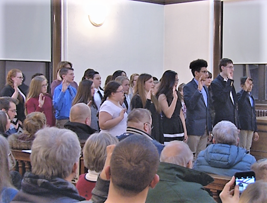 Several new members of Elmira Youth Court are sworn in during a recent ceremony.