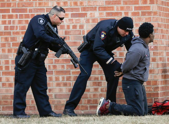 City of Fond du Lac Police officers take a person that ran from them, into custody Wednesday, Jan, 9, 2019 at a apartment complex near the corner of Pioneer Road and Martin Avenue.