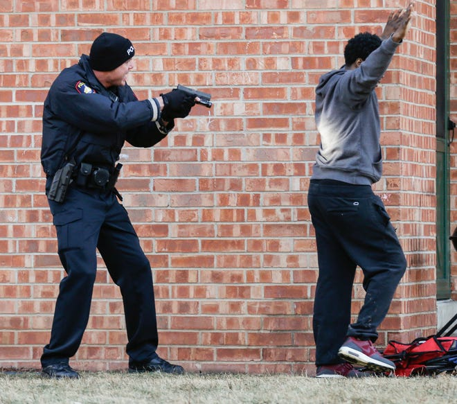A City of Fond du Lac Police officer takes a person that ran from them, into custody Wednesday, Jan. 9, at an apartment complex near the corner of Pioneer Road and Martin Avenue.
