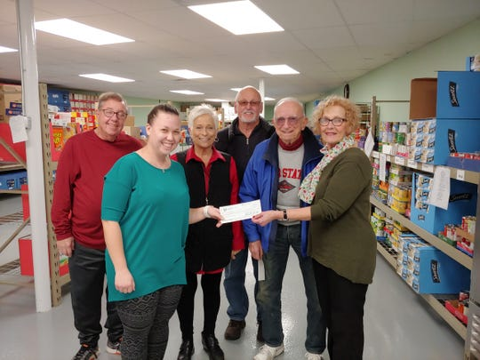 Accepting the donations were Food pantry volunteers, joined by Elk members Diann Hamons, Larry Hamons, John Walker, and Mary Beaston