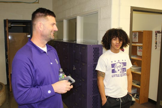 John Cahill, pictured left, heads the Personalized Learning Center program at Fremont Ross High School. Senior Deryante Hardin talked to Cahill Monday in the PLC lab at Ross.