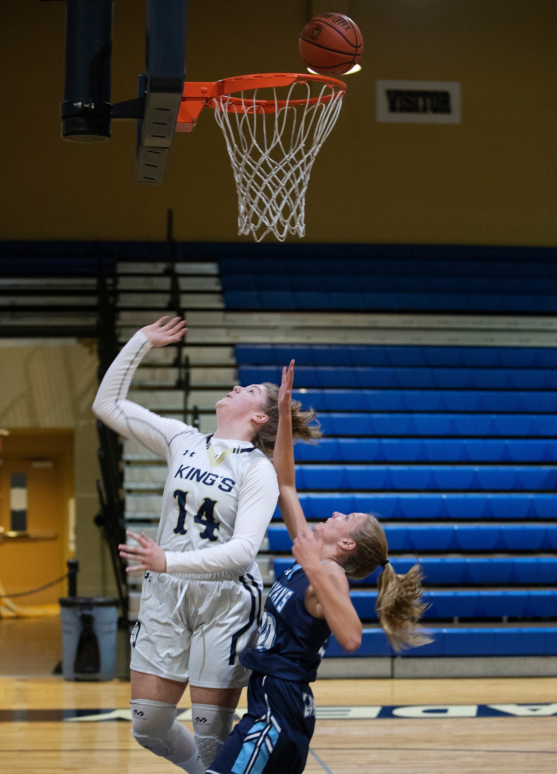 Southwest Florida Christian Academy's Rebekah Bergquist (14) scores her 2,501 point against Marco Island on Thursday at SFCA in Fort Myers.