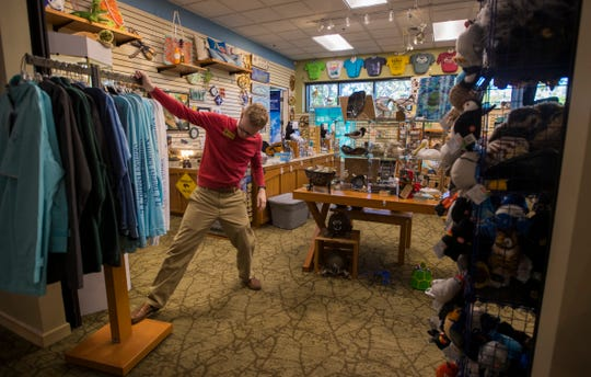 Christopher Galloway, an assistant store manager at the Ding Darling Nature Store, prepares to open on the morning January 10, 2019. Although Galloway works primarily at the store and is not a federal employee, he and his coworkers have stepped up efforts to assist in other ways in order to mitigate the void of furloughed workers.