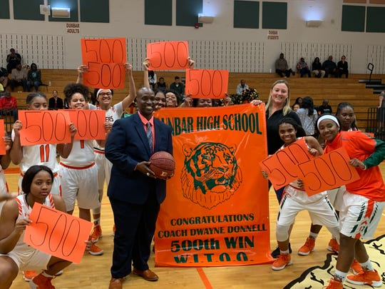 Dunbar High School honored girls basketball coach Dwayne Donnell for reaching 500 career wins Dec. 29 following a 59-15 win over Port Charlotte on Wednesday.