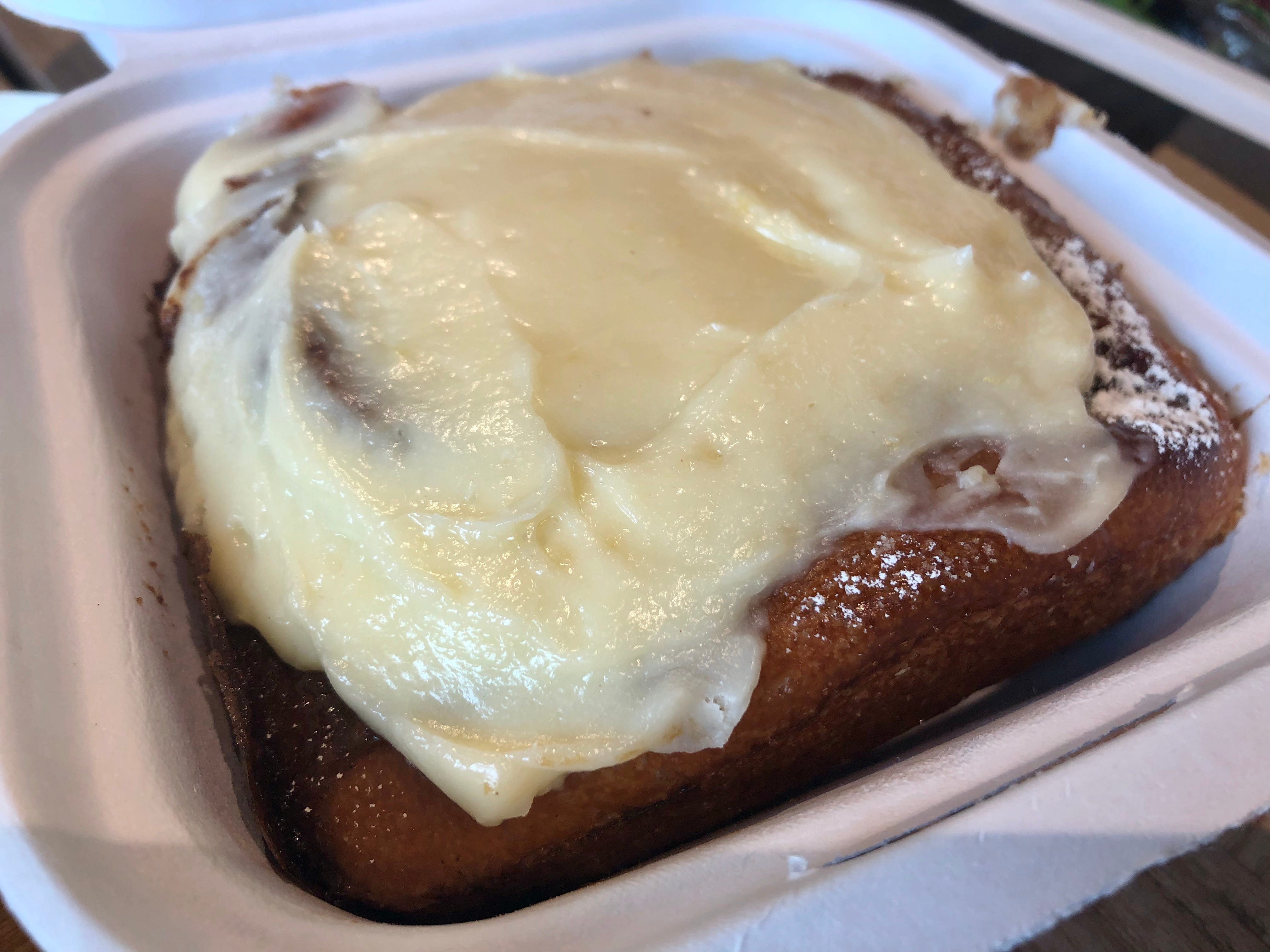 A house-baked cinnamon roll slathered in cream-cheese frosting from Norman Love Confections Cafe inside the Whole Foods Market in south Fort Myers.