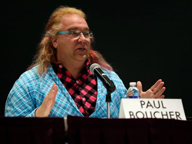 Green Bay mayoral candidate Paul Boucher speaks  at a Jan.9 forum at the Brown County Central Library.