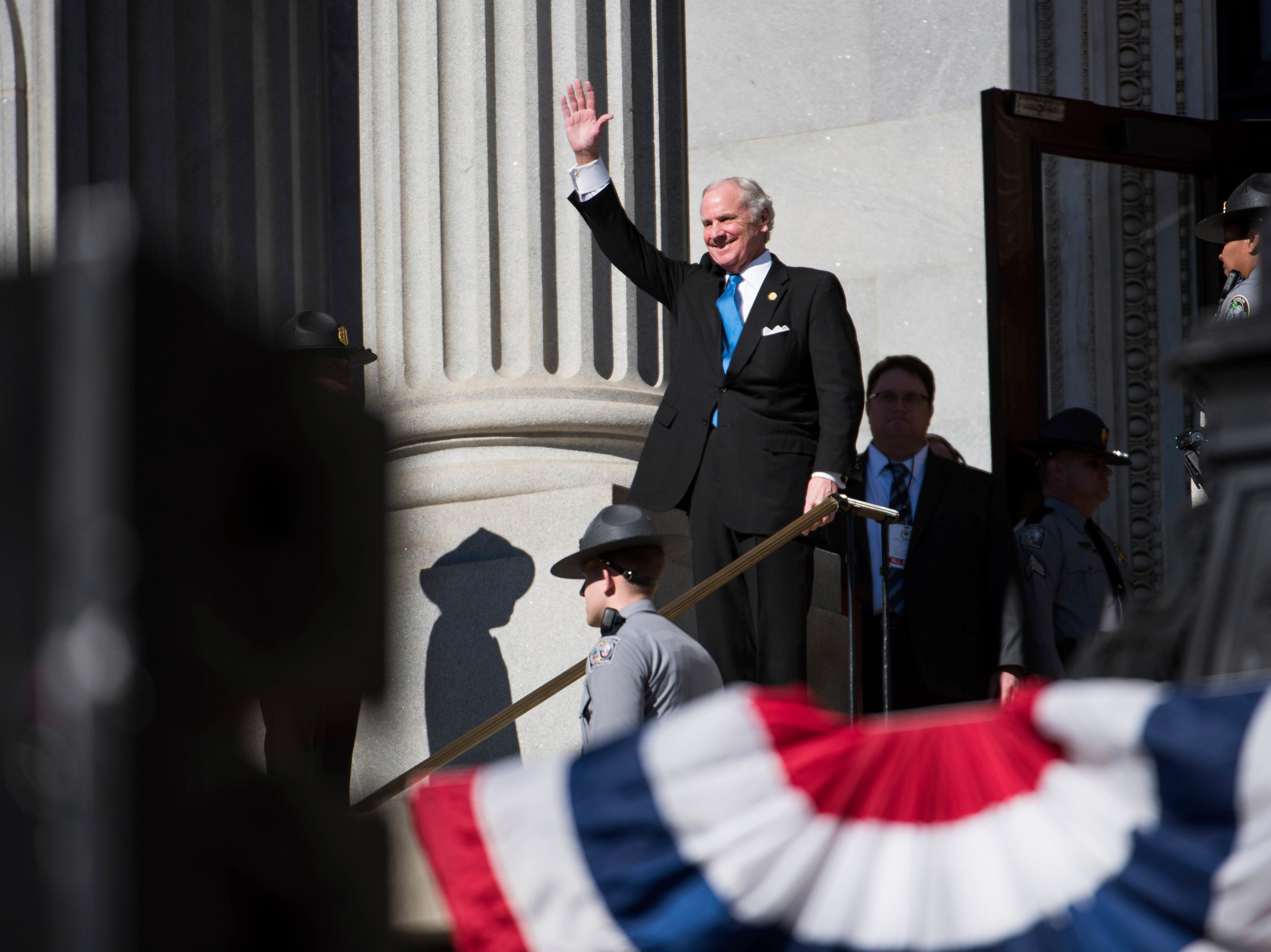 South Carolina Governor Henry McMaster waves to the crowd during his inauguration ceremony at the South Carolina Statehouse Wednesday, Jan. 9, 2019, in Columbia, S.C. McMaster defeated Democratic state Rep. James Smith in the Nov. 6 election. (AP Photo/Sean Rayford)