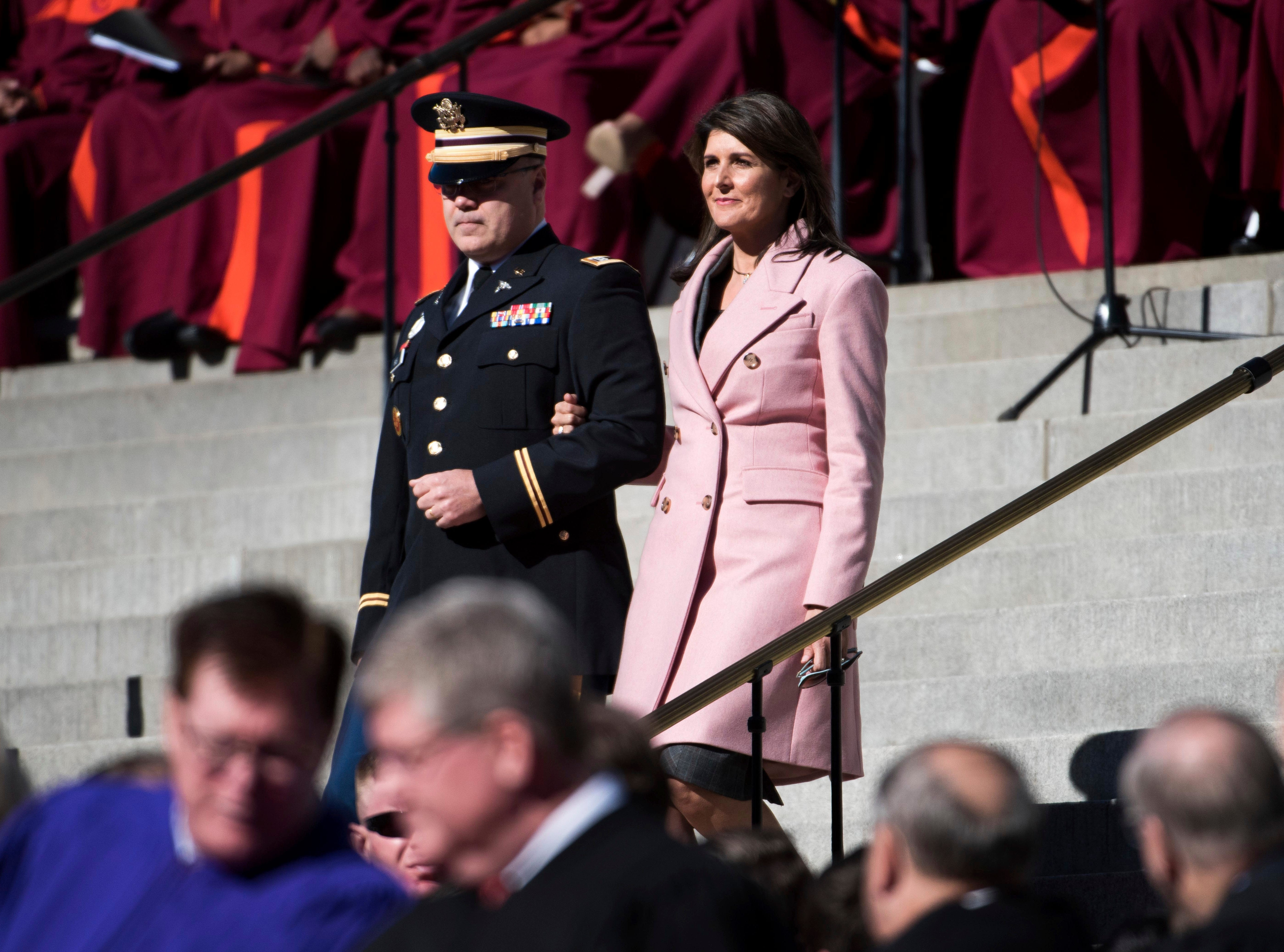 Former United Nations Ambassador and South Carolina Governor Nikki Haley, right, walks with her husband Michael Haley during the inauguration ceremony for South Carolina Governor Henry McMaster Wednesday, Jan. 9, 2019, in Columbia, S.C. (AP Photo/Sean Rayford)
