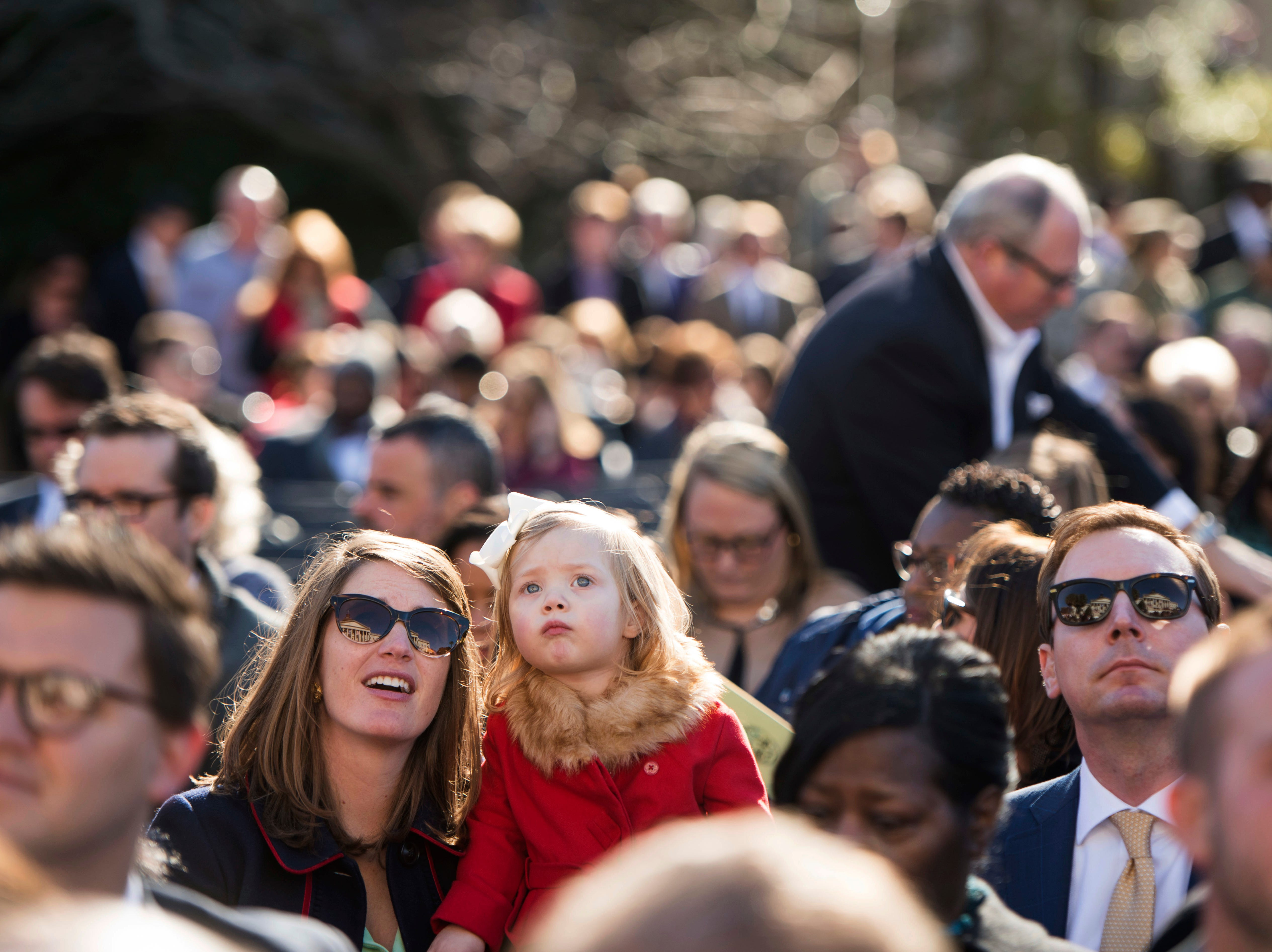 People in the crowd wait for the start of the inauguration ceremony of South Carolina Gov. Henry McMaster at the South Carolina Statehouse, Wednesday, Jan. 9, 2019, in Columbia, S.C. McMaster defeated Democratic state Rep. James Smith in the Nov. 6 election. (AP Photo/Sean Rayford)