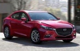A photo of a red Mazda sedan.
