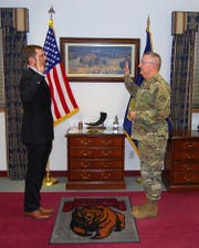 UM President Seth Bodnar, left, is sworn into the Montana Army National Guard by Maj. Gen. Matthew Quinn on Jan. 8 at Fort Harrison.