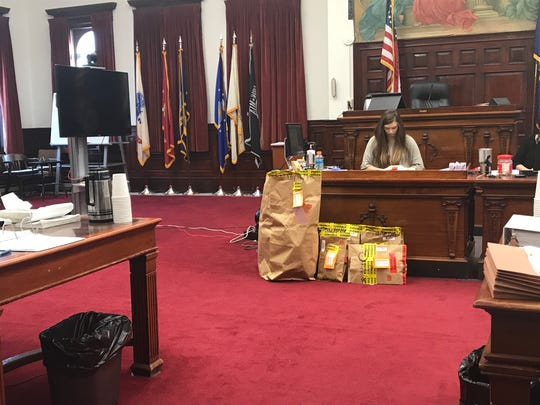 Evidence bags from the Malcolm Joseph Newrobe Sr. case sit on the floor of the Great Falls district courtroom Thursday, January 10, 2019.