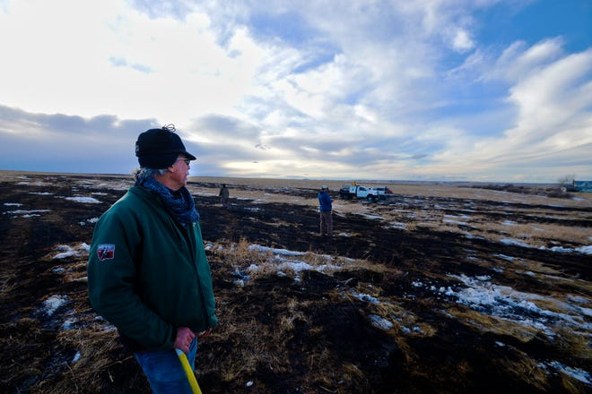 """Curt Clarke feels fortunate after a grass fire erupted and burned dangerously close to his home outside of Stockett. """"I don't know how it started here in the middle of the field,"""" he said."""