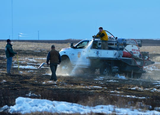 Land owners and rural firefighters put out a fast moving grass fire on Cottonwood Coulee Road, Wednesday.